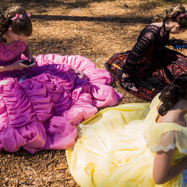 Cape Fear Garden Club Azalea Belles check their phones during a break at the queen's coronation at the 72nd North Carolina Azalea Festival at Greenfield Lake Amphitheatre in Wilmington, N.C., on Wednesday, April 3, 2019. [NATHAN BURTON/STARNEWS]