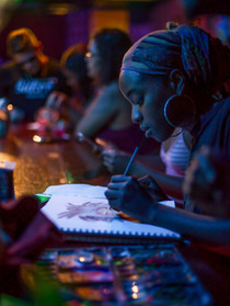 Artist Tejiri Adjekpiyede, A&T student, paints at Artists Bloc in Greensboro, N.C. during Why Not Wednesday's open mic on Wednesday, September 5, 2018. (Photo by Nathan Burton)