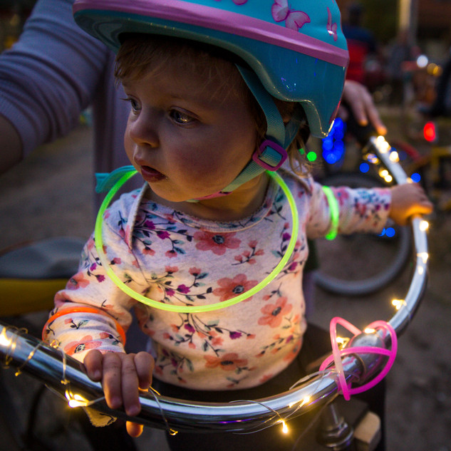 Anna Garmin, 15 months, attends the lighted bike parade with her mother, Olivia, during the 4th annual Alt-Zalea Music Festival on Saturday April 6, 2019 in Wilmington, N.C. Alt-Zalea Fest is a free, volunteer music festival that highlights local musicians. [NATHAN BURTON/STARNEWS]