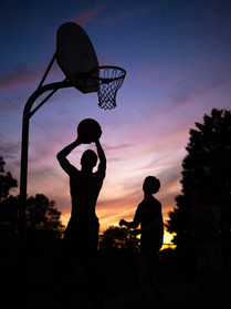 Teenagers play a game of pick-up basketball as the sun sets in Asheboro, N.C. on Saturday, September 29, 2018. (Photo by Nathan Burton)