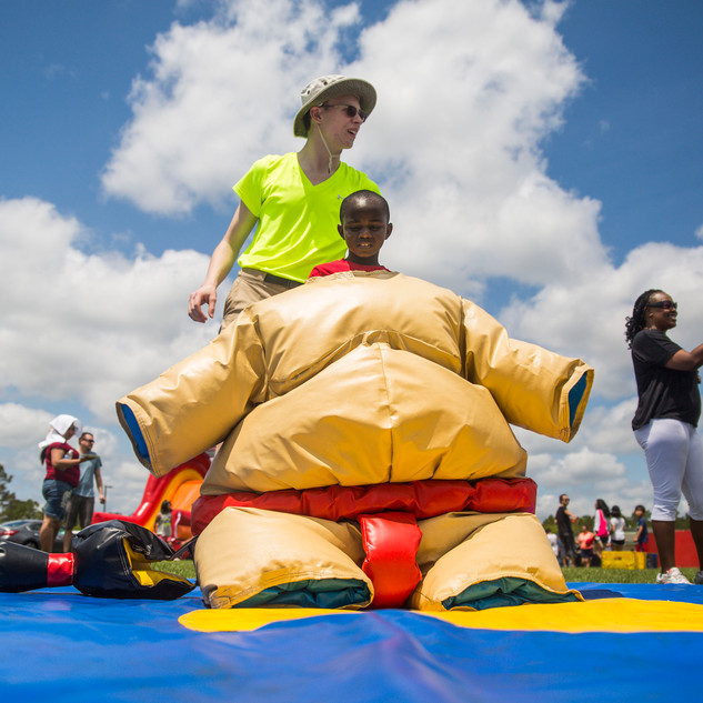 Daquan McCain, 8, tries on a sumo wresting suit during the 20th Annual Festival Latino at Ogden Park in Wilmington, NC on Saturday May 4, 2019. [NATHAN BURTON/STARNEWS]