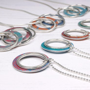 2 and 5 hoop aluminium and silver pendants