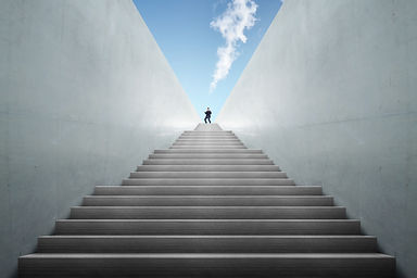 Image of person at top of stairs.