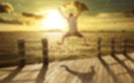 Image of man jumping into water.