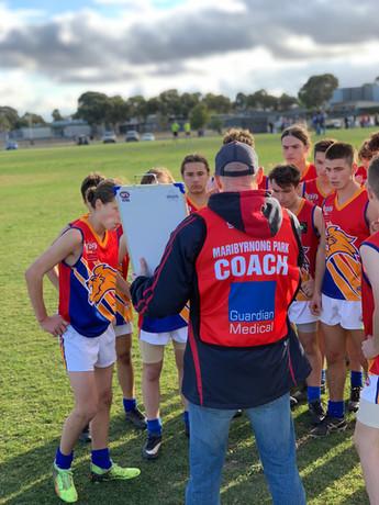 Coach addressing our U14 boys