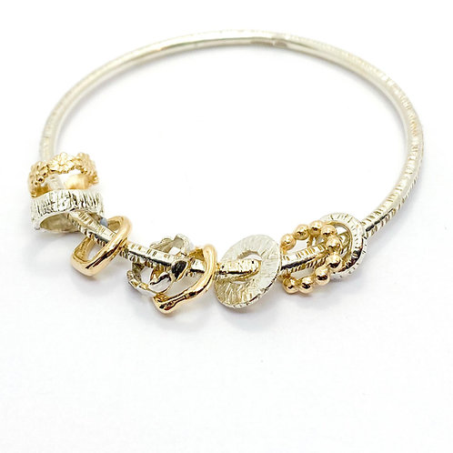 Sterling Silver Bangle adorned with Gold Beads