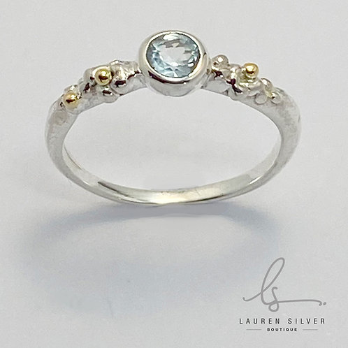 Sterling silver and topaz ring