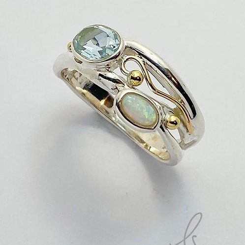 Slim classic organic ring , set with Blue Topaz , opalite