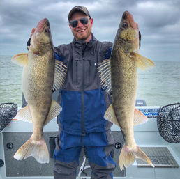 Terry With Two Trophy Lake Erie Walleye