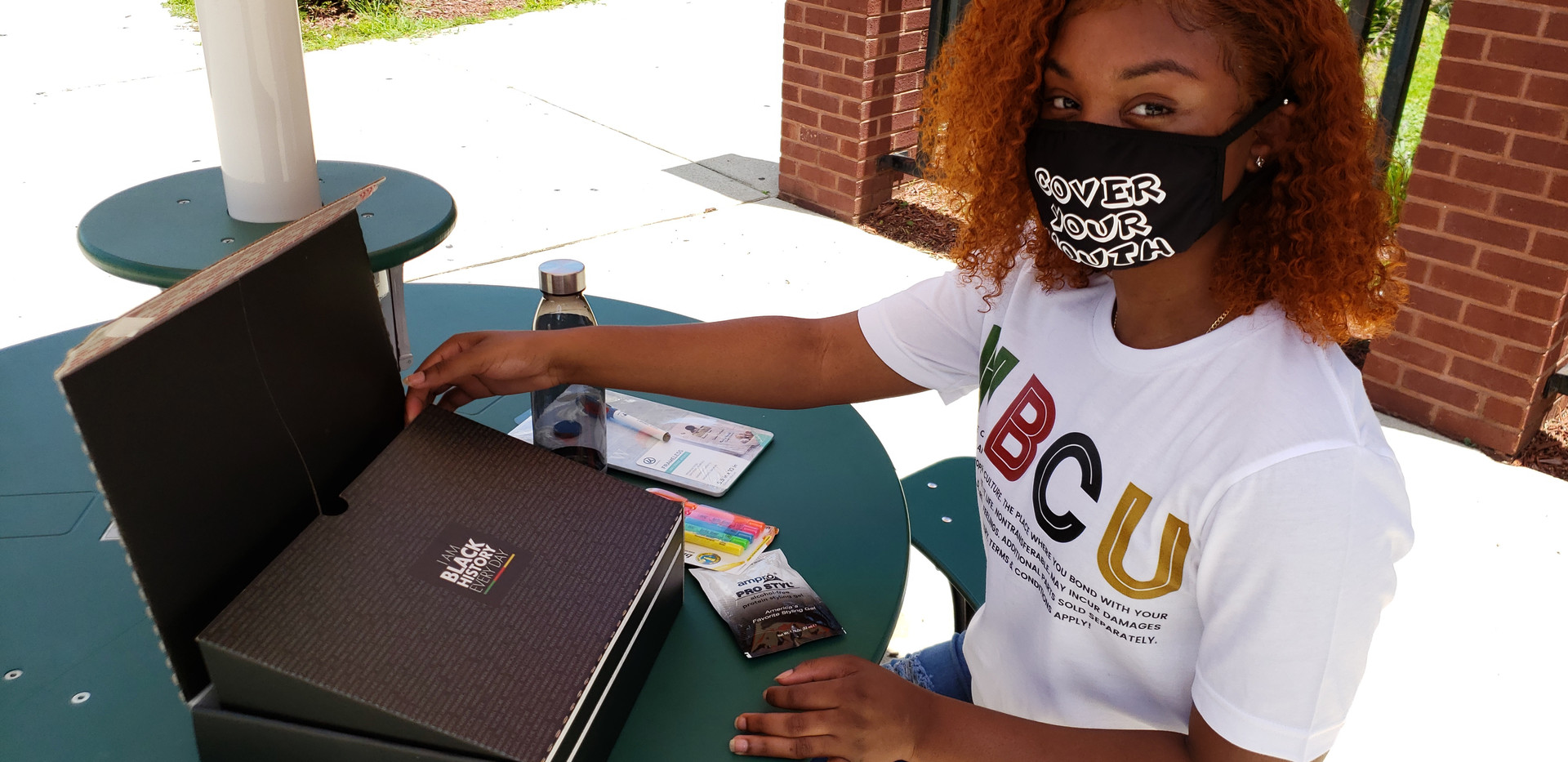 Student with HBCU Box