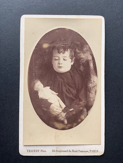 Post Mortem Child holding a Doll