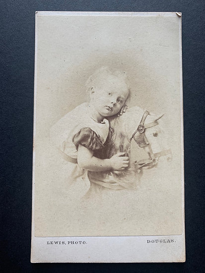 Victorian Child on Rocking Horse