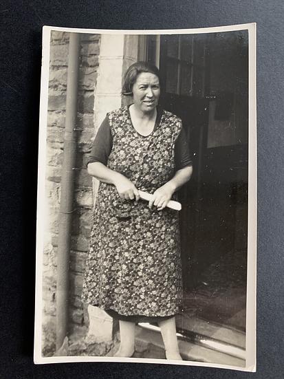 Lady on her doorstep Postcard