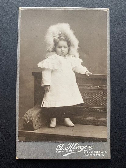Child in Feather Bonnet