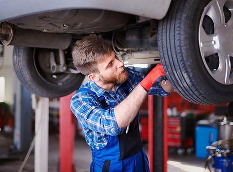 mechanics-repairing-car-workshop.jpg