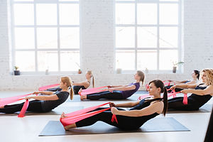 Group of six women are doing stretching