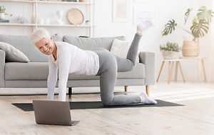 Fitness at home. Sporty senior woman exe
