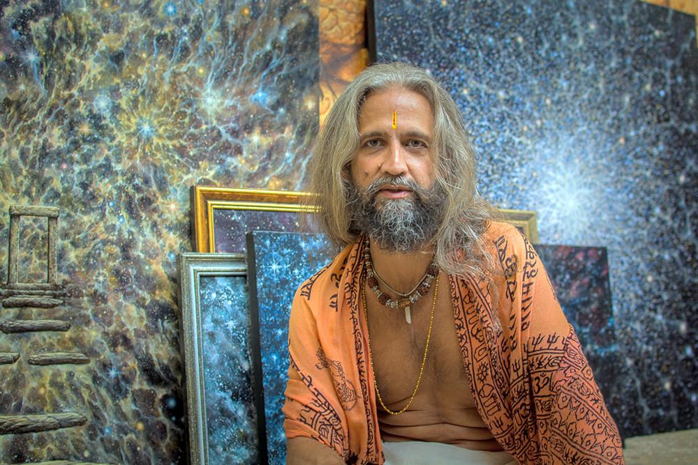 Rahju with his paintings