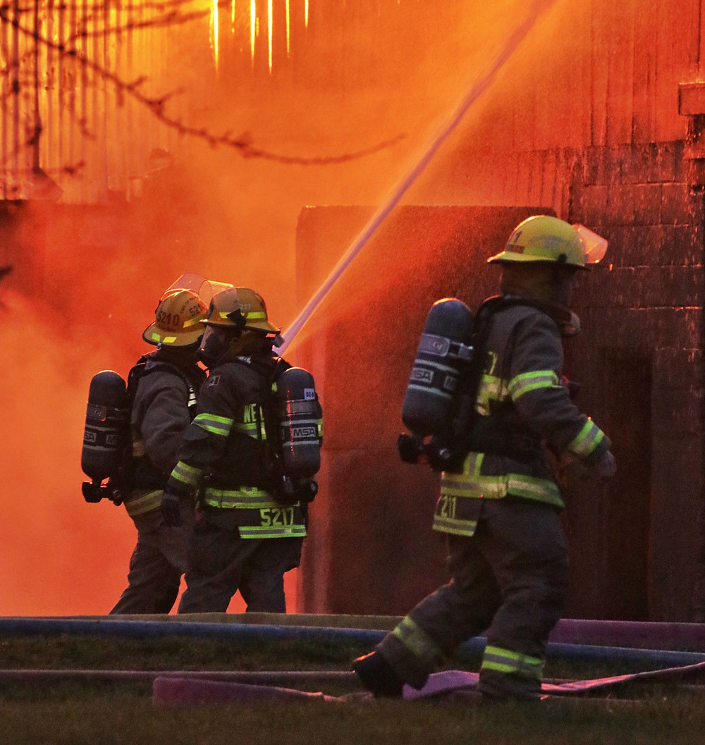Stock photo of firefighters fighting a fire
