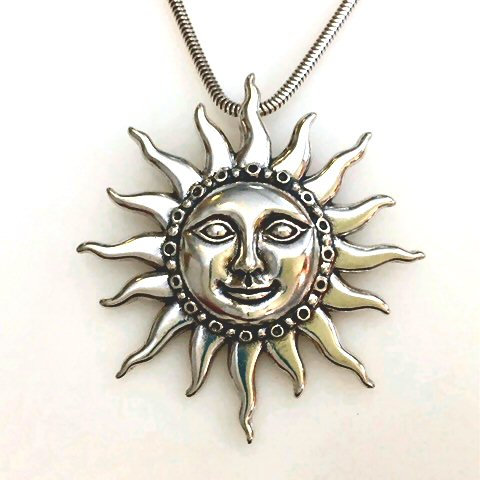 "Silver Sun Pendant with 18"" snake chain"