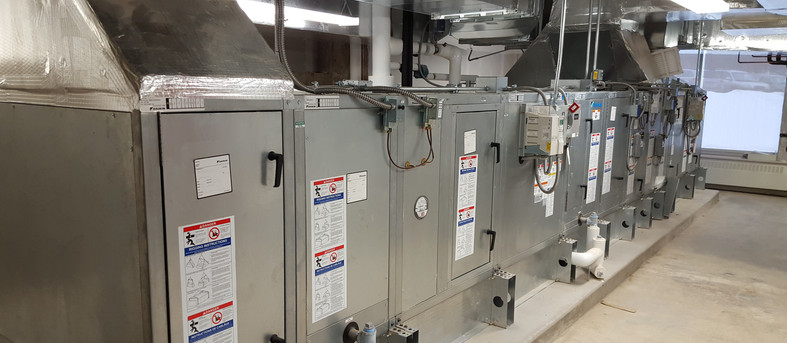 Indoor air handling unit with stream heating coil and DX cooling coil serving a Dialysis Clinic