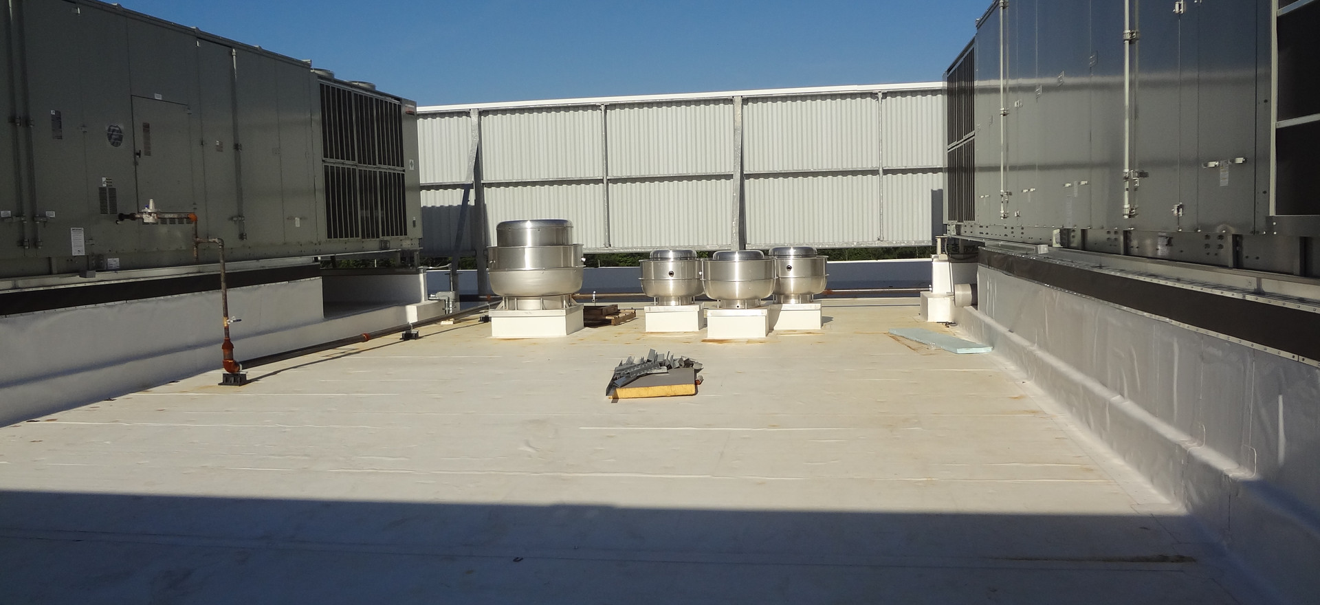 Two 100 Ton rooftop unit, air cooled condensing units and exhaust fans on multi-story Medical Office Building