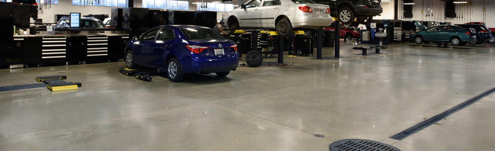 Automotive repair garage utility services and floor drainage system