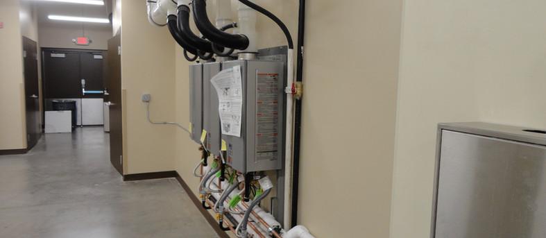 Space saving high efficiency tankless water heaters