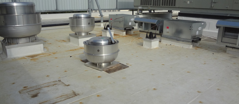 100 Ton rooftop unit, air cooled condensing units and exhaust fans on multi-story Medical Office Building