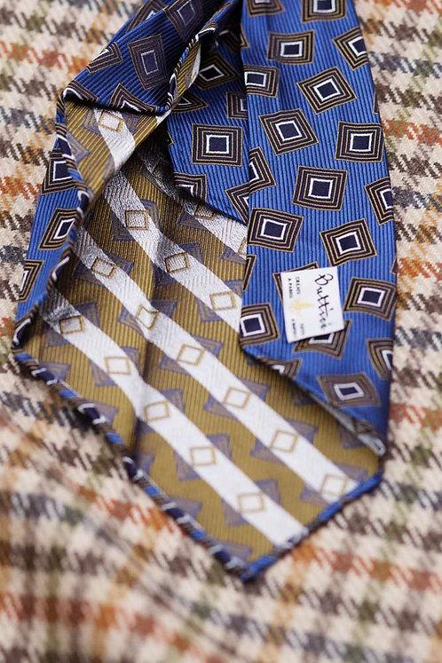 Cravate jacquard bleue 7 plis : motifs carrés bruns