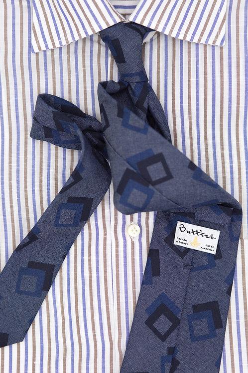 Cravate imprimée bleue : motifs carrés bleus