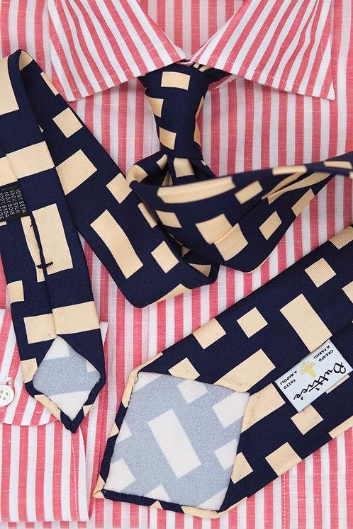 Cravate imprimée bleue : motifs rectangles blanc ivoire