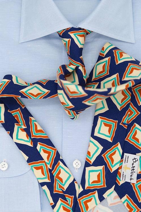 Cravate imprimée bleue : motifs carrés ocre/émeraude