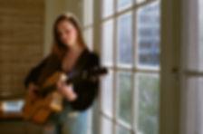 lucy_guitar_window_looking_down.jpg