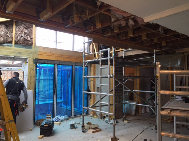 Steel beams now installed where old outside wall of house used to be