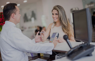 Woman-at-the-hair-salon-paying-by-card-0