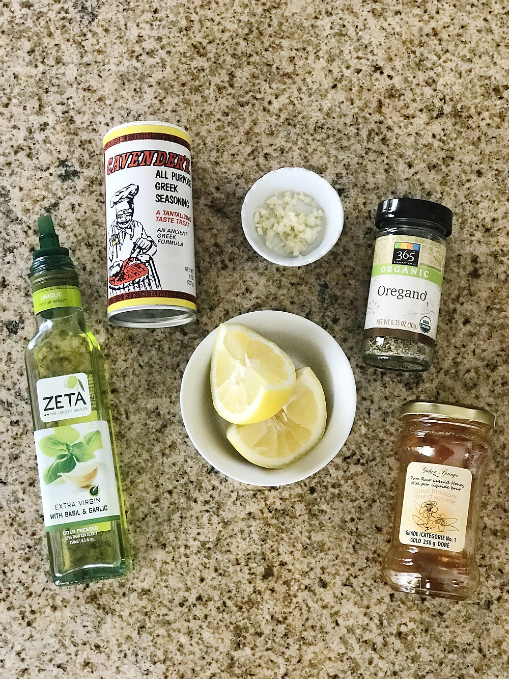 Zeta Olive Oil, Cavender's Greek Seasoning, Chopped Garlic, Organic Oregano, Sliced Lemons, & Honey