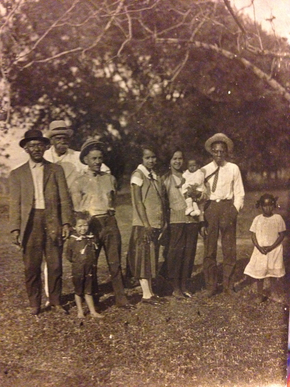 "Sunday ancestors standing on the land that their home would be built on. Seraphine ""Nanny"" Hernandez (center, skirt) ,husband Walker Hernandez (R), sister Olive Frances (my great-grandmother), and niece (Helen Perkins)"