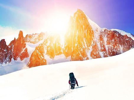 Hiker-peaks and sun_shutterstock_6912250