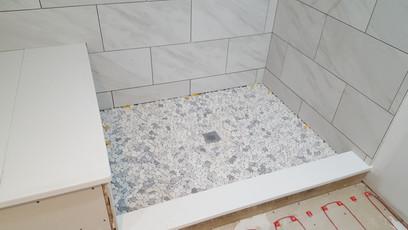 shower pebble tile floor