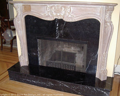 Nero Marquina marble fireplace surround