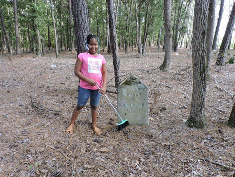Zoe (Richard Green's great great grand daughter) brushing off the grave stone
