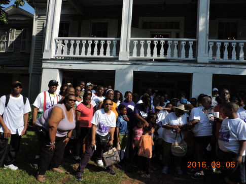 Group photo in front of McCord House