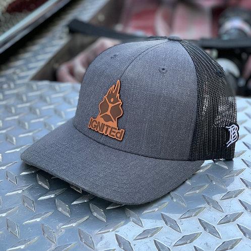 IGNITEd snapback curved brim hat.