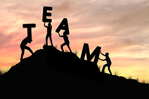 silhouette team work of men helping and