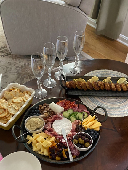 charcuterie board and crab cakes