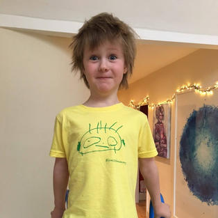 The kid who inspired this whole movement, wearing our Kid's 'Frazzled Mummy' T