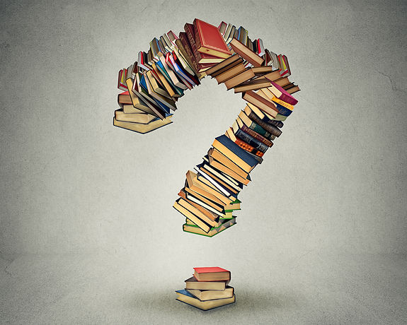 Question mark made of books ask search a