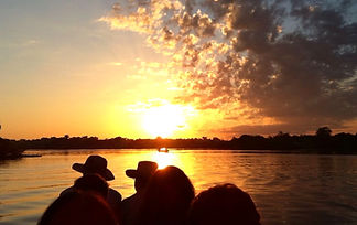 Jaguar Amazon Tours Manaus Brazil Adventure Tour Tourists viewing the Amazon Sunset