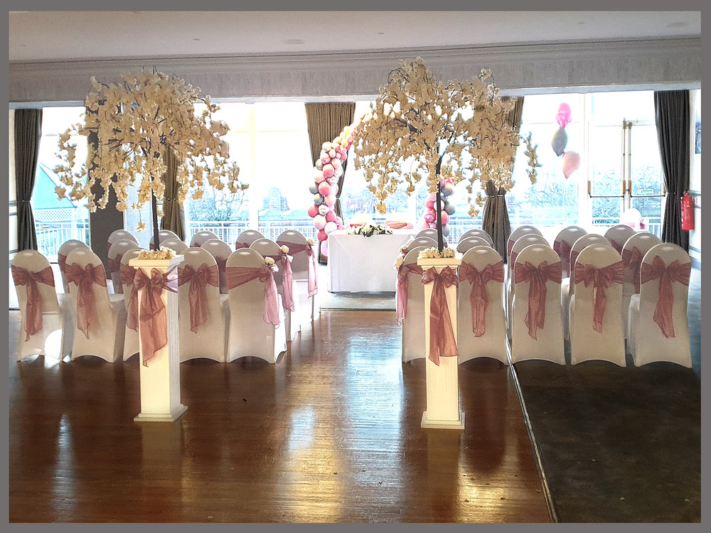 BLOSSOM TREES CHAIR COVERS MAUVE BLUSH PINK SASHES WEDDING AISLE HOTEL WEDDING BALLOON ARCH VICTORIA HOTEL